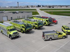 Arial view of 7 yellow fire vehicles