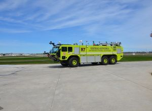 Yellow Fire truck on runway R7